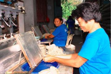 Women laborers making silk yarn from silk waste (spunsilk)