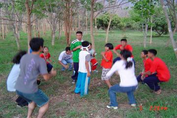 School children enjoying the nature game held under the trees.